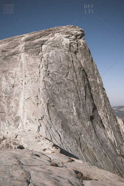Climbers ascending cable secured section of Half Dome in Yosemite NP