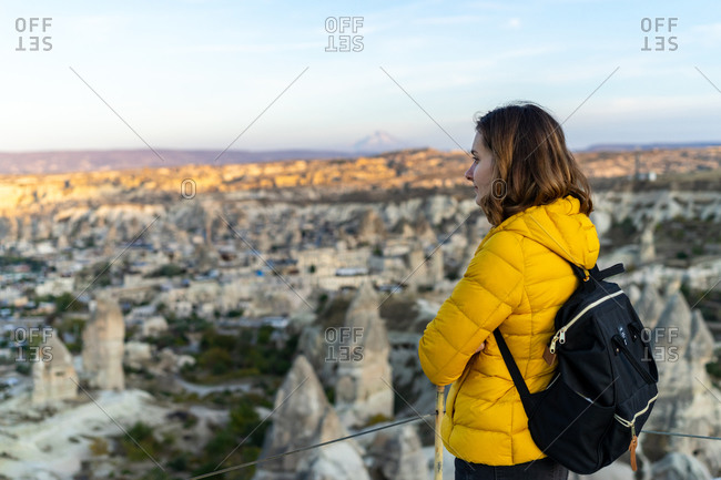Woman is soaking in sunset in Goreme Turkey