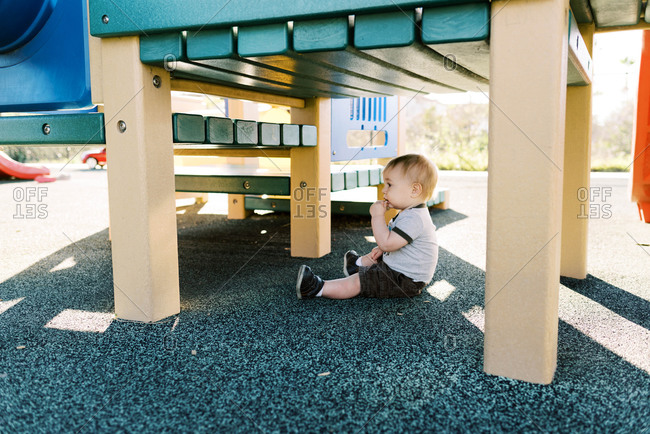One year old exploring the playground.