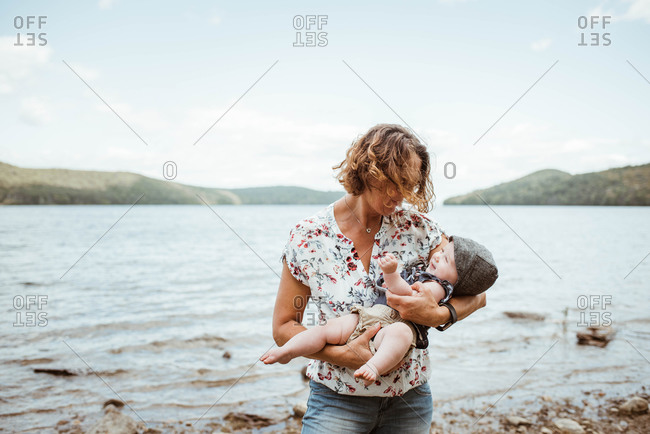 Grandmother holding her granddaughter during a trip to the lake.