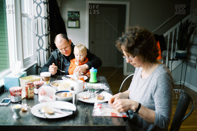 Grandparents with their grandson during breakfast.