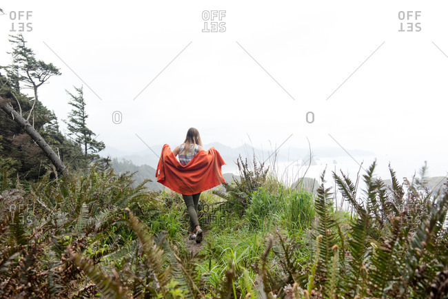 Female hiker explores the green coast