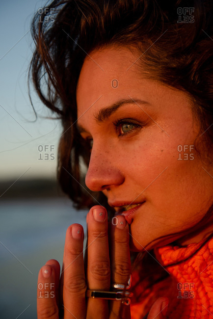 Peaceful woman takes in the view at sunset