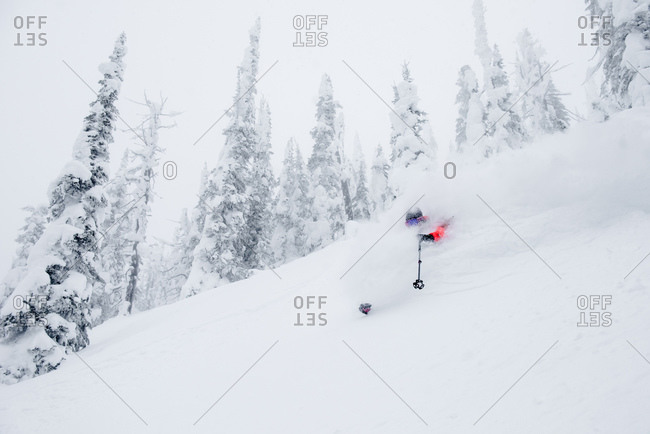 Female skier find deep powder in the backcountry of British Columbia