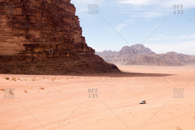 Tourists explore the vastness of the Wadi Rum desert in Jordan.