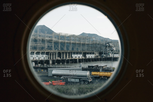 The Bonneville Dam near Cascades Locks in Oregon seen through a window