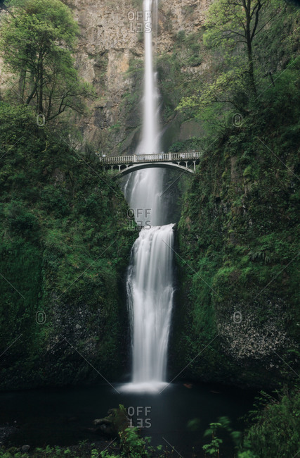A bride over Multnomah Falls in Oregon.