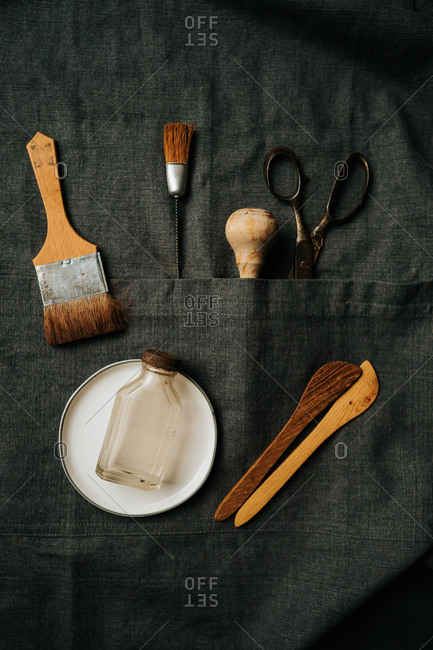 Collection of brushes and tools on dark background