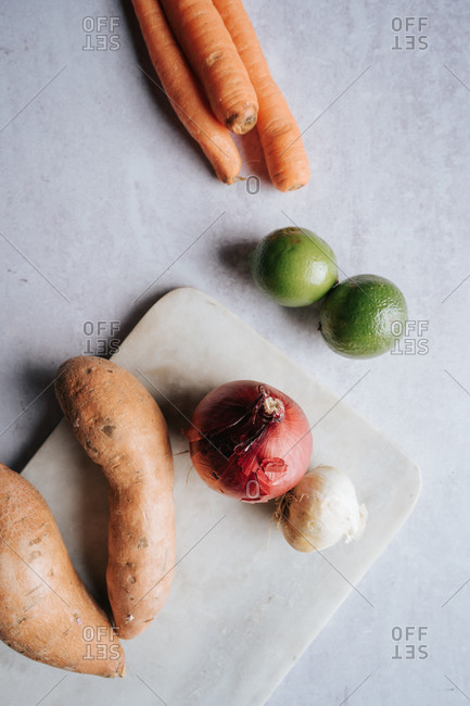Collection of whole veggies on white countertop