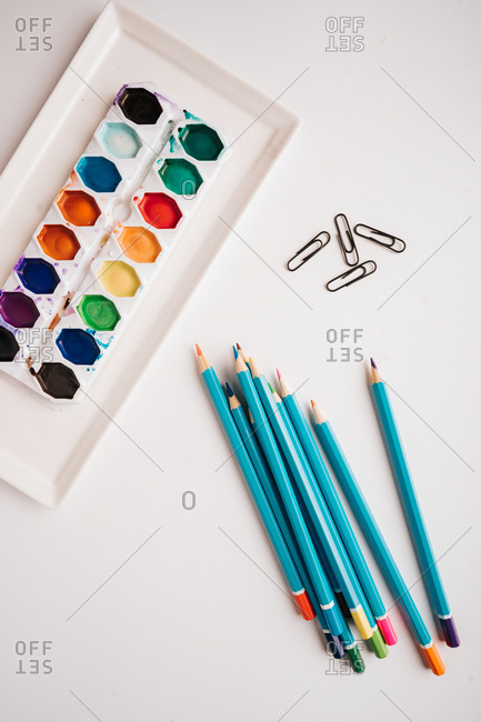 Colorful art supplies on white background