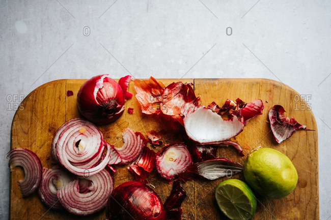 Bright veggies chopped up on cutting board.