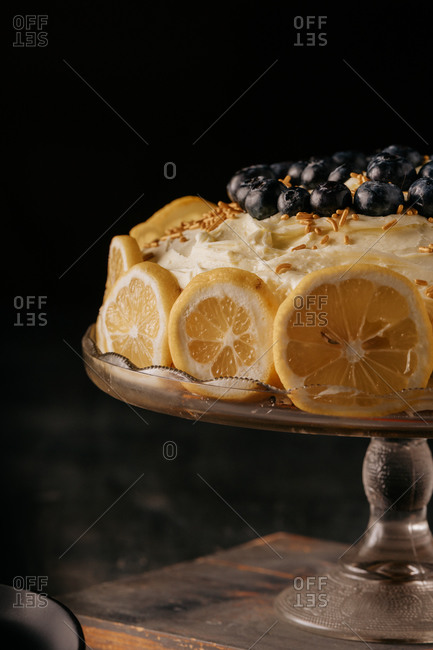 Close up of sliced lemon cake on moody table