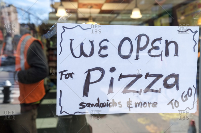 Open sign on a pizza shop during the Coronavirus outbreak in New York City, New York