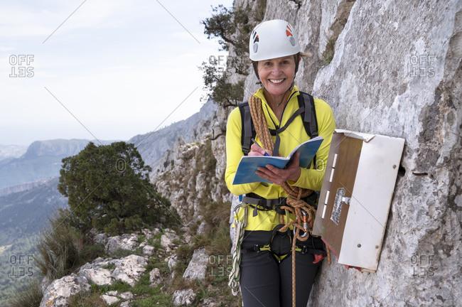 Portrait of smiling mountaineer at Bernia Ridge- Costa Blanca-  Alicante- Spain