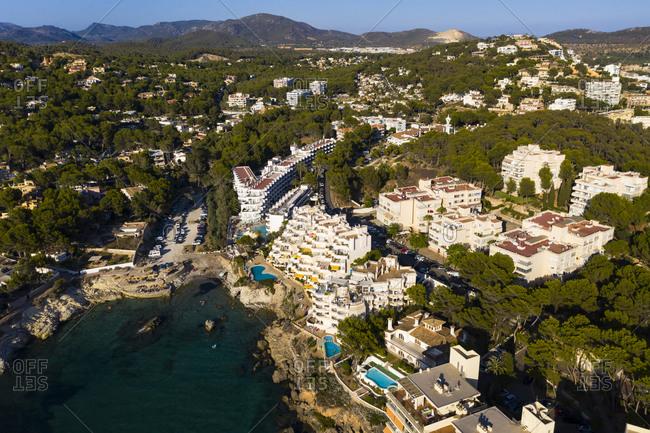 Spain- Balearic Islands- Costa de la Calma- Aerial view of coastal town in summer