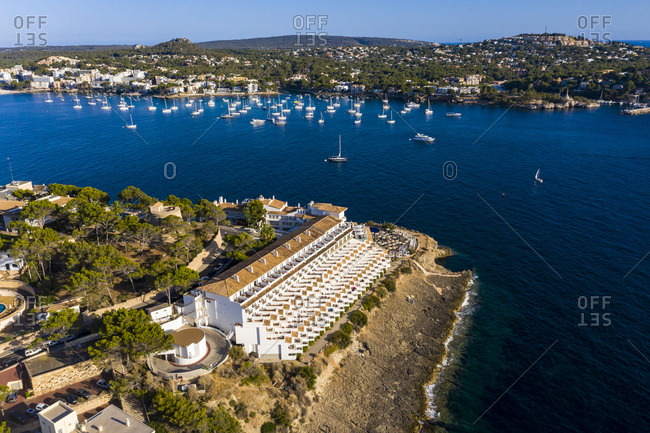 Spain- Balearic Islands- Costa de la Calma- Aerial view of coastal town in summer with sailboats sailing in background