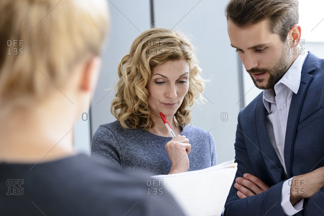 Senior businesswoman talking to colleagues in a business meeting
