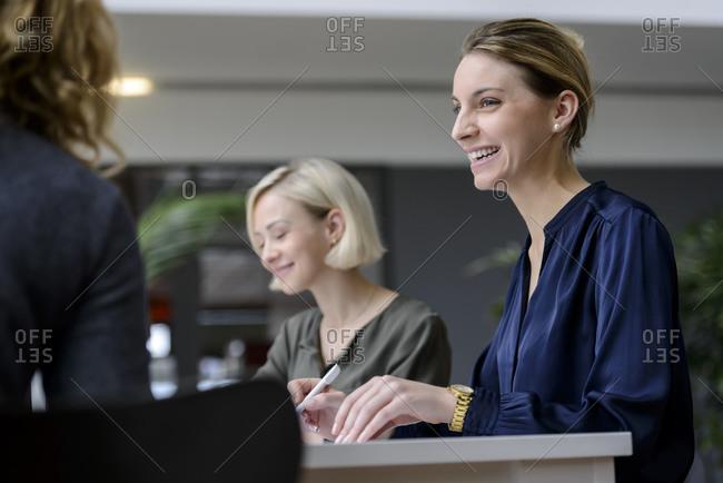 Attentive businesswomen sitting meeting- listening smiling