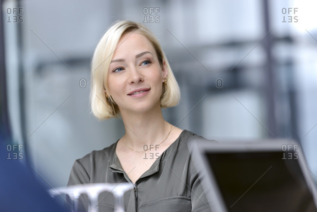 Attentive businesswoman sitting meeting- listening focused