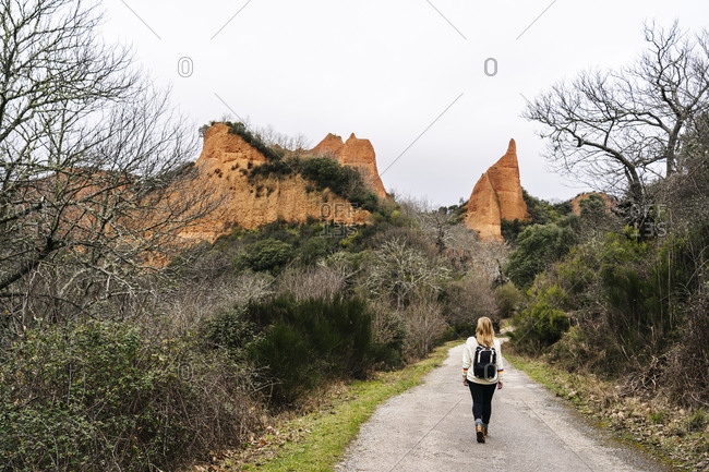 Hiker on hiking trail at Mina de Oro Romana- former gold mine- Las Medulas- Castile and Leon- Spain