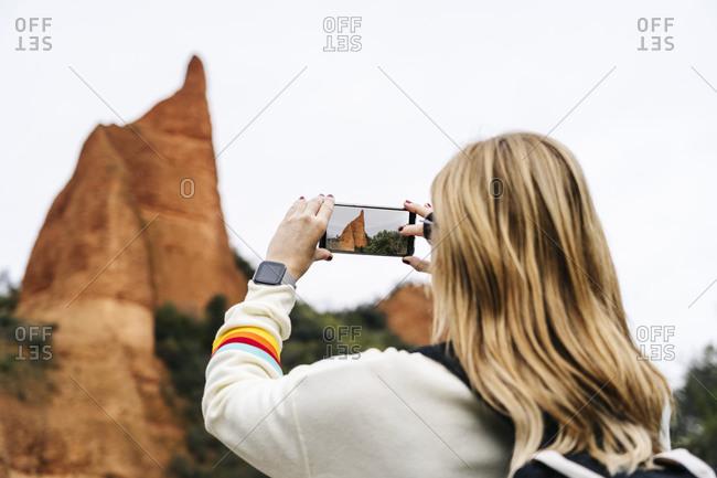 Female hiker photographing at Mina de Oro Romana- Las Medulas- Castile and Leon- Spain