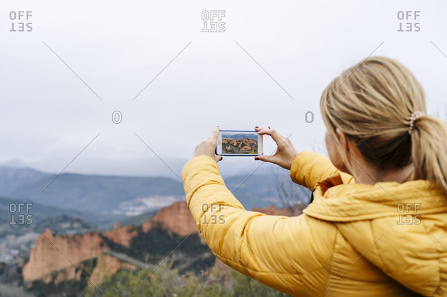 Female hiker photographing Mina de Oro Romana- Las Medulas- Castile and Leon- Spain