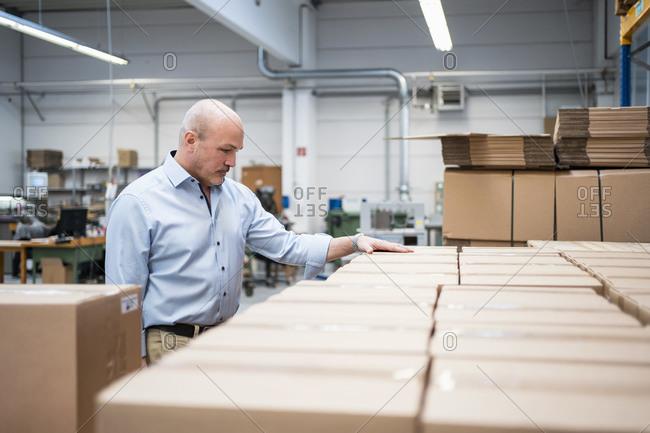 Businessman in a factory storage