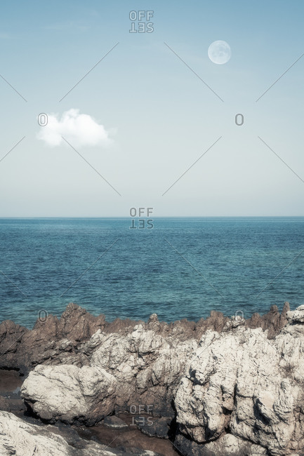 Spain- Balearic Islands- Canyamel- Rocky shore of Mediterranean Sea with clear line of horizon in background