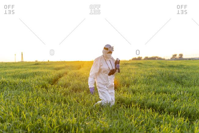 Female scientist researching in field