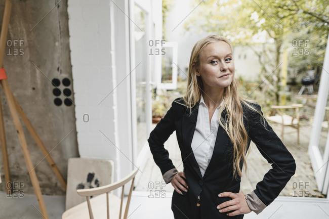 Portrait of a confident blond young businesswoman