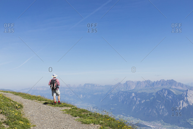Switzerland- St Gallen Canton- Glarus Alps- Man hiking the Panoramic hiking trail in the Tectonic Arena Sardona