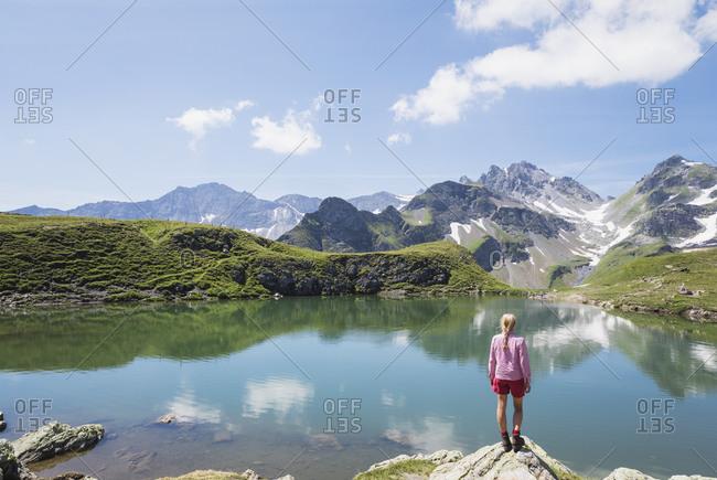 Switzerland- St Gallen Canton- Glarus Alps- Woman looking at Wangs Lake