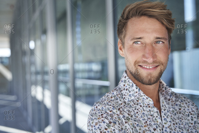 Portrait of smiling young man wearing patterned shirt