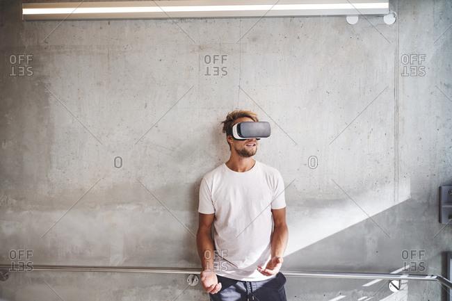Young man wearing virtual reality goggles