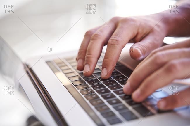 Businessman using laptop- close-up