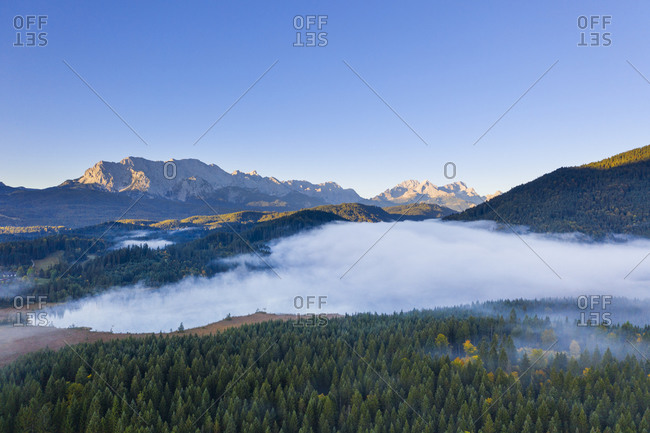 Germany- Bavaria- Krun- Drone view of Barmsee lake shrouded in thick fog