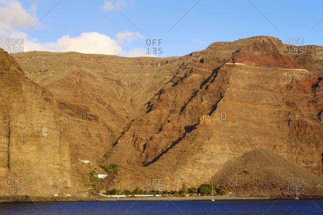 Spain- La Gomera- Valle Gran Rey- Brown coastal cliff of La Gomera island