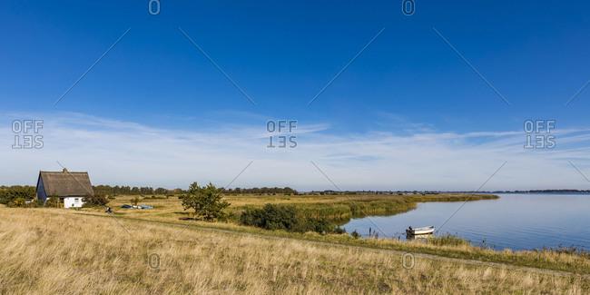 Germany- Mecklenburg-Western Pomerania- Neuendorf- Sky over grassy coastline in spring