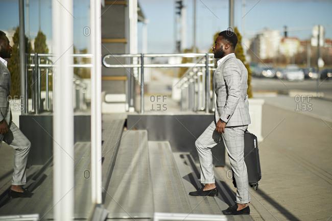Businessman entering hotel