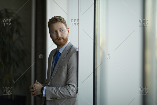 Portrait of a businessman looking out of window