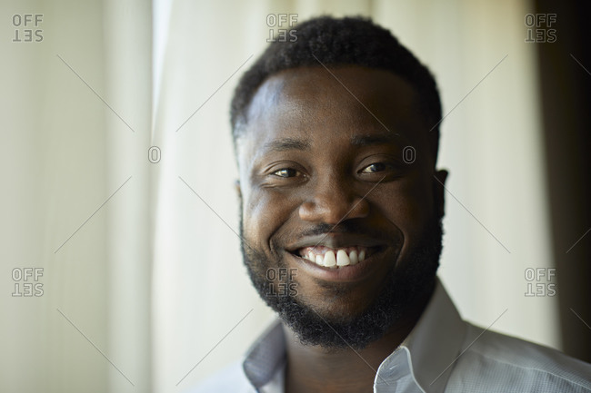 Portrait of smiling businessman at the window