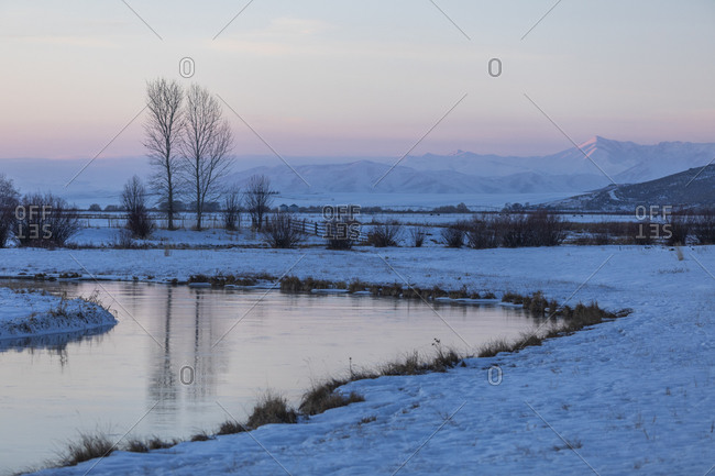 Snow by a stream at sunset in Picabo, Idaho