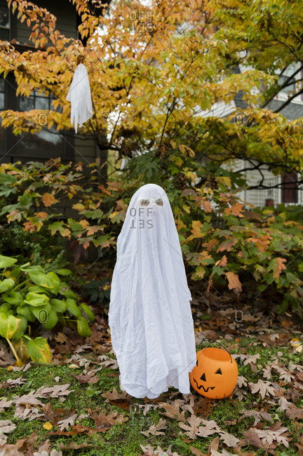 Boy in ghost costume for Halloween