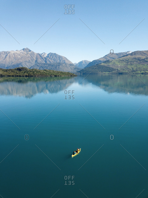 Aerial view of a two people paddling a canoe on Lake Wakitipu, Otago region, South Island, New Zealand