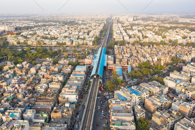 March 18, 2020: Aerial view of New Delhi public transport system crossing neighborhood, India.