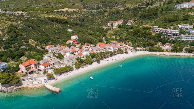 Aerial view of coastline and beach in Krvavica near the city of Makarska in Dalmatia, Croatia.