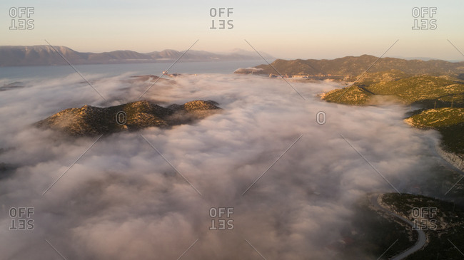 Aerial view of misty morning over Neretva valley near the city of Pole in Dalmatia, Croatia.