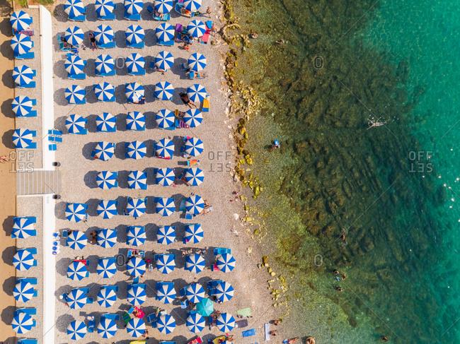 Aerial view of umbrellas at Alba Chiara Beach Medulin, Croatia