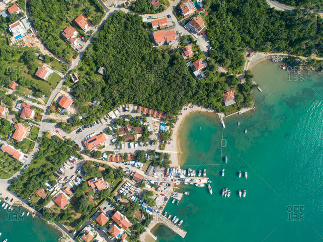 Aerial view of houses and boats on the shore of the bay in Klimno, Croatia