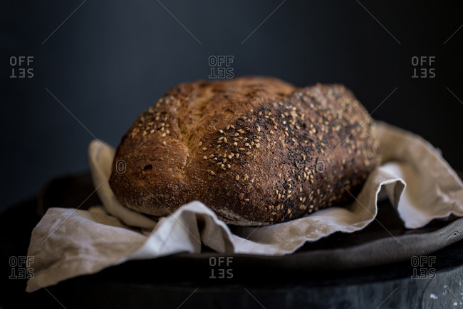 Loaf of fresh baked bread on linen cloth